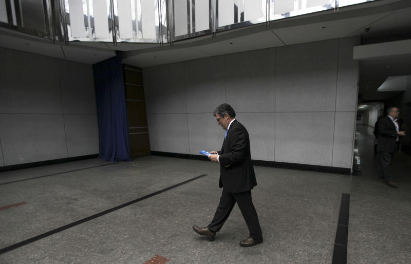 Marcel Granier, director of Radio Caracas Television Station (RCTV), leaves after a news conference with the foreign media at his office in Caracas, Venezuela, Tuesday, May 22, 2012. The opposition-aligned TV channel, which was forced off the air nearly five years ago by the Venezuelan government, used to employ thousands but now very few roam the studios. RCTV transmits via cable TV outside Venezuela. (AP Photo/Fernando Llano)