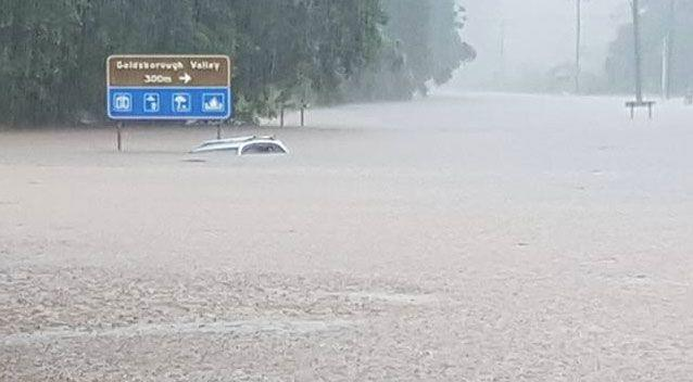 An elderly man drove into Cairns floodwaters on Thursday and became trapped. Photo: Facebook/ Sam Greenwood