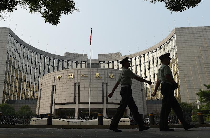 The People's Bank of China on August 13, 2015, trimmed the reference rate for the yuan by 1.11% to 6.4010 yuan for $1, from the previous day's 6.3306 (AFP Photo/Greg Baker)