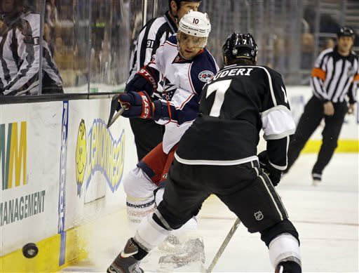 Columbus Blue Jackets right wing Marian Gaborik (10) and Los Angeles Kings defenseman Rob Scuderi (7) battle in the first period of an NHL hockey game in Los Angeles, Thursday, April 18, 2013. (AP Photo/Reed Saxon)