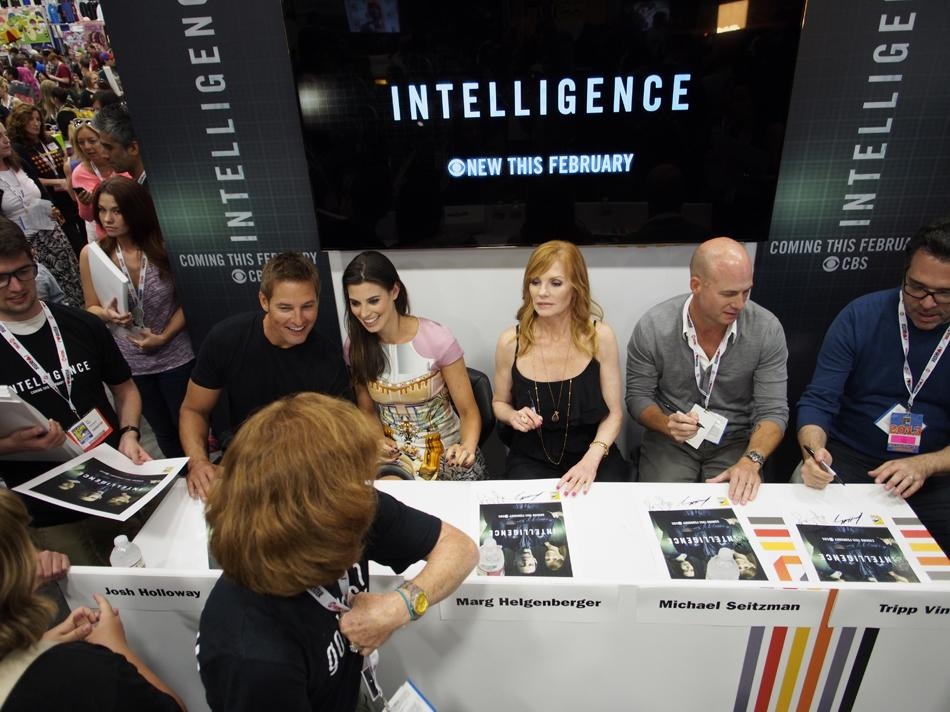 "Josh Holloway, Meghan Ory, Marg Helgenberger, and producers Michael Seitzman and Tripp Vinson at the ""Intelligence"" booth signing during Comic-Con International 2013 at San Diego Convention Center on July 18, 2013 in San Diego, California."