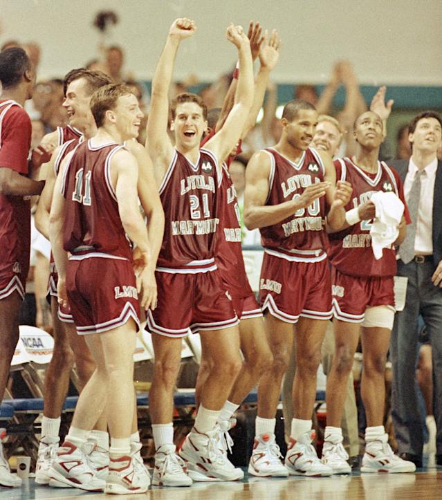 <p>Just a few days after the tragic death of star player Hank Gathers, who collapsed during a conference tournament game due to a heart condition, the Lions had to find the motivation to compete in the NCAA tournament. And compete they did, fighting all the way to the regional final as an 11 seed thanks to wins over No. 3 Michigan and No. 7 Alabama. Loyola and its run-and-gun offense was led by Bo Kimble, who put together one of the great tourney performances of all time. His 35.8 points per game average is tied for third in NCAA tournament history. It was a heroic performance by a player who admirably honored the memory of his lost teammate. </p>