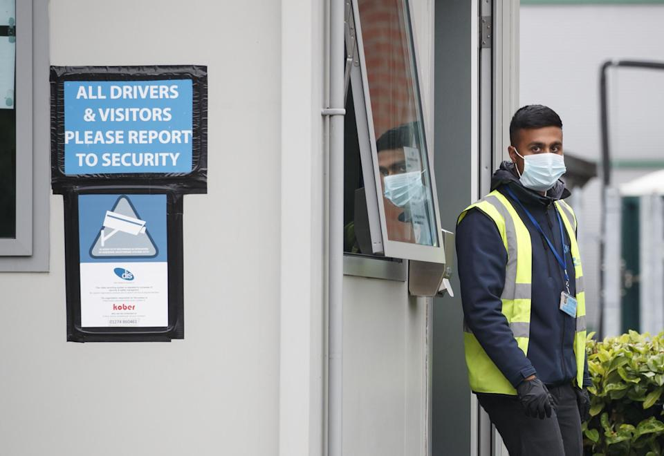 A security guard at Kober meat processing plant in Cleckheaton: PA