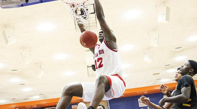 """<p>Zion Williamson is headed to Duke. In a news conference at his high school on Saturday, the highest-ranked undecided high school senior revealed that he has verbally committed to the Blue Devils, choosing them over finalists Clemson, Kansas, Kentucky, North Carolina and South Carolina. The announcement comes after he took official visits to Duke, North Carolina, Kansas and Kentucky, in addition to unofficial visits to in-state schools South Carolina and Clemson.</p><p>Williamson, a five-star forward in the class of 2018, recently returned to the court for Spartanburg Day (S.C.) School after an extended absence because of a foot injury. He participated in a prestigious tournament pitting teams from around the country, the Hoophall Classic, in Springfield, Mass., last weekend. In a game televised on ESPN against the high school team the Ball brothers played for (Chino Hills), Williamson put up 36 points.</p><p>The decision surprised most familiar with Williamson's recruitment. A much less heralded program, Clemson, was viewed as the favorite in the leadup to the announcement.</p><p>• <strong><a href=""""https://www.si.com/longform/2017/zion-williamson-basketball-dunks-high-school/index.html"""" rel=""""nofollow noopener"""" target=""""_blank"""" data-ylk=""""slk:LONGFORM: How Zion Williamson Went Global in the Viral Era"""" class=""""link rapid-noclick-resp"""">LONGFORM: How Zion Williamson Went Global in the Viral Era</a></strong></p><p>Williamson is not regarded as the best prospect in the country; he checks in at No. 2, behind Duke small forward commit R.J. Barrett, in the Recruiting Services Consensus Index (RSCI), a composite that incorporates data from multiple services. But Williamson has a strong case for being the most famous player who currently suits up for an American high school, particularly given LaMelo Ball's recent move to a Lithuanian pro team.</p><p>By the time Zion Williamson revealed his college choice on Saturday, he'd already drawn hundreds of thousand of views on YouTube"""