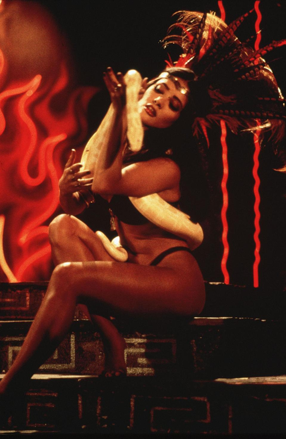 """<strong><em><h3>From Dusk Till Dawn </h3></em></strong><h3>(1996)<br></h3><br>We'll sell you on the sex appeal of this vampire film quickly. Salma Hayek plays a vampire goddess named Santanico Pandemonium who specialises in a """"snake dance,"""" and is but one vampire working in a bar straight out of <em>True Blood</em>.<span class=""""copyright"""">Joyce Podell/Los Hooligans/A Band Apart/Kobal/REX/Shutterstock</span>"""