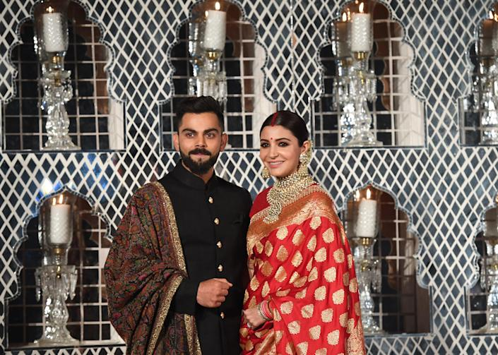 <p>Virat Kohli and Anushka Sharma at their wedding reception in New Delhi in 2017</p> (Getty Images)