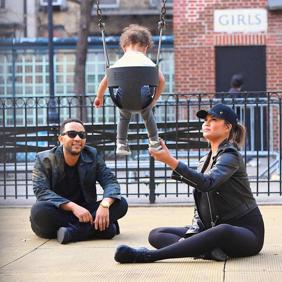 <p>The couple play with their daughter in a playground in New York City.</p>