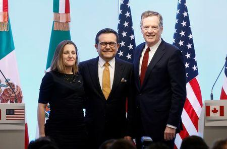 FILE PHOTO - Canadian Foreign Minister Chrystia Freeland, Mexican Economy Minister Ildefonso Guajardo and U.S. Trade Representative Robert Lighthizer pose for a photo during a joint news conference on the closing of the seventh round of NAFTA talks in Mexico City, Mexico March 5, 2018. REUTERS/Edgard Garrido