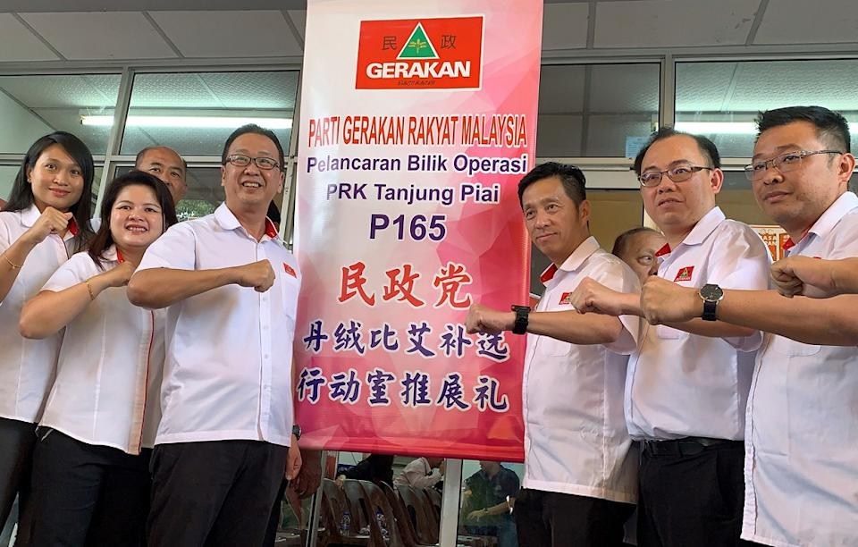 Gerakan president Datuk Dominic Lau (third left) said the party's machinery has been busy making house-to-house visits to remind the family who have members outstation to return home and cast their votes tomorrow. — Bernama pic