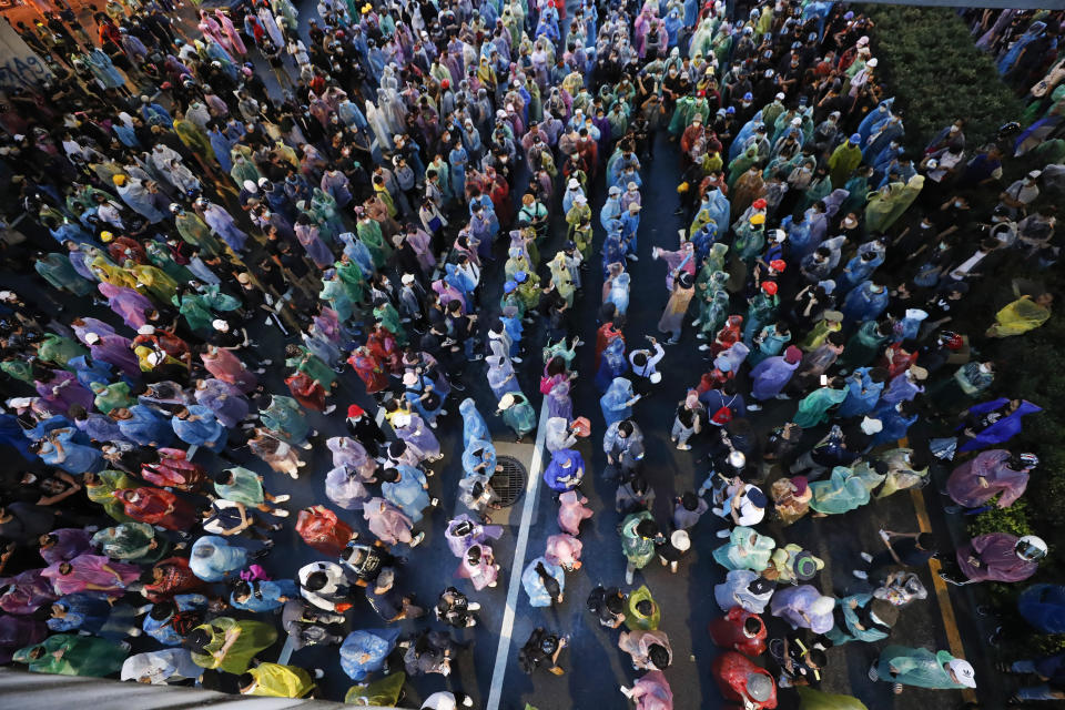 Pro-democracy protesters gather during a protest in Bangkok, Thailand, Saturday, Oct. 17, 2020. The authorities in Bangkok shut down mass transit systems and set up roadblocks Saturday as Thailand capital faced a fourth straight day of determined anti-government protests. (AP Photo/Sakchai Lalit)