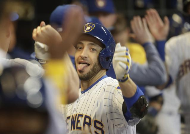 Milwaukee Brewers' Ryan Braun celebrates his three-run home run during the third inning of a baseball game against the St. Louis Cardinals Friday, March 29, 2019, in Milwaukee. (AP Photo/Morry Gash)