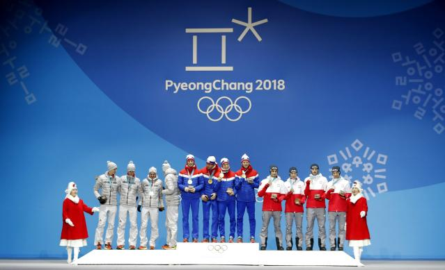 Medals Ceremony - Ski Jumping - Pyeongchang 2018 Winter Olympics - Men's Team - Medals Plaza - Pyeongchang, South Korea - February 20, 2018 - Gold medalists Daniel Andre Tande, Andreas Stjernen, Johann Andre Forfang and Robert Johansson of Norway, silver medalists Karl Geiger, Stephan Leyhe, Richard Freitag and Andreas Wellinger of Germany and bronze medalists Maciej Kot, Stefan Hula, Dawid Kubacki and Kamil Stoch of Poland on the podium. REUTERS/Eric Gaillard
