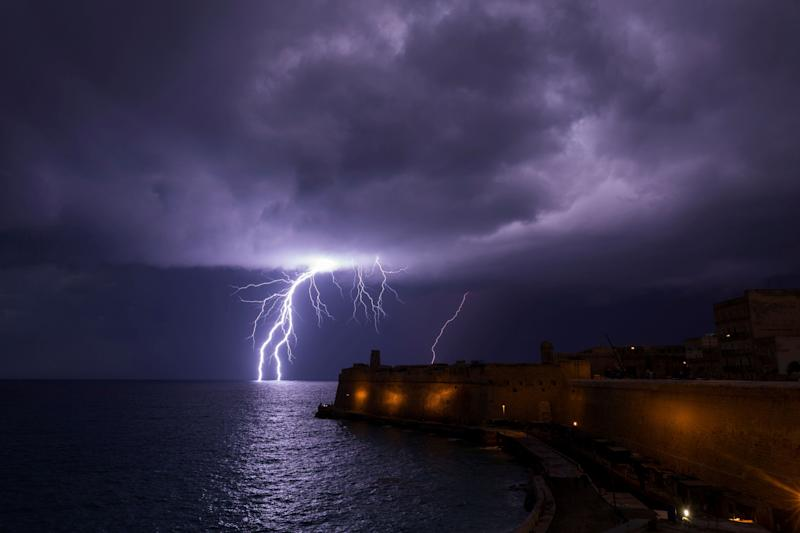 A lightning bolt strikes the sea near Fort St Elmo during a storm in Valletta, Malta February 27, 2019.