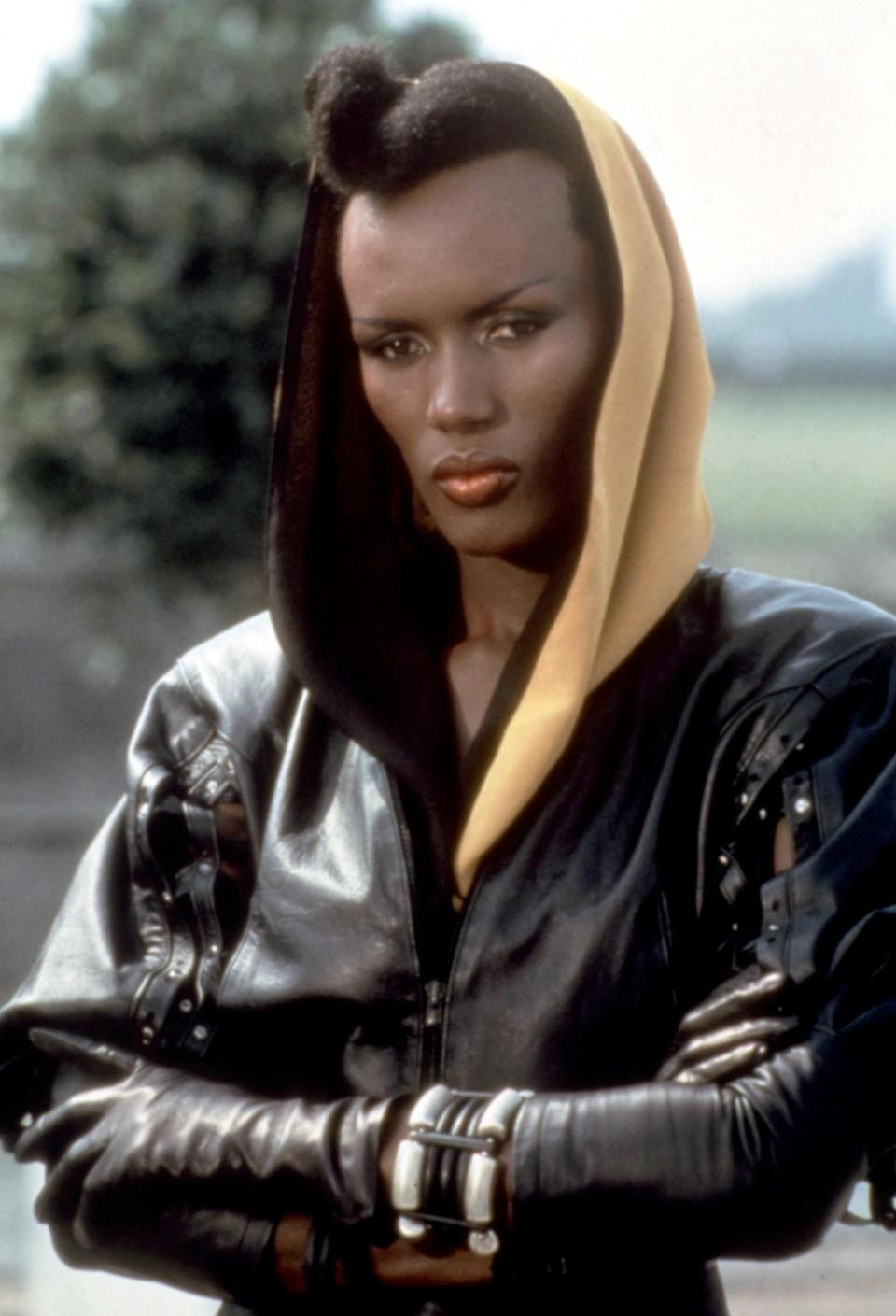 <p>As lover and henchwoman to industrialist Max Zorin (played by Christopher Walken), it's easy to understand why her name is May Day — her superhuman strength will have you begging for mercy. And yes, Grace Jones is just as cool on the big screen as she is though her music, rocking purple eyeshadow, headscarves, and killer stilettos with her edgy androgynous look. <i>Photo: Everett Collection</i></p>