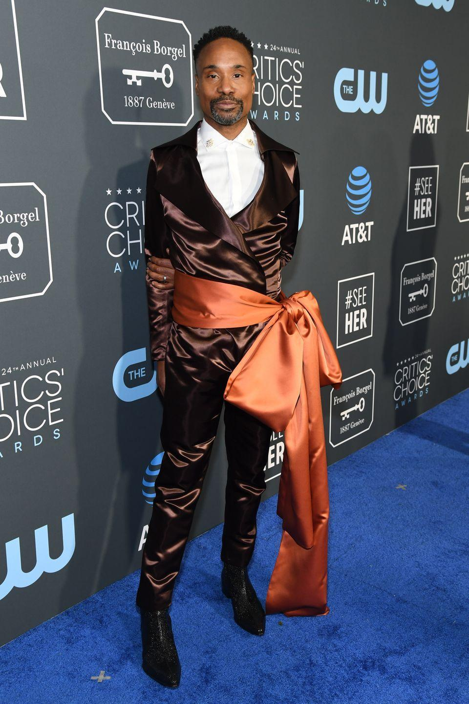 <p>Porter at the 24th annual Critics' Choice Awards in a brown silk suit and copper-colored sash. </p>