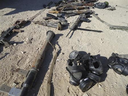 Weapons are seen in the sand near Adra, east of Damascus