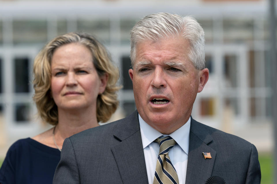 Suffolk County Executive Steve Bellone, right, speaks at a news conference to discuss a settlement in an opioid trial, Tuesday, July 20, 2021, in Central Islip, N.Y. Nassau County Executive Laura Curran is behind him. New York State reached an agreement Tuesday with the distribution companies AmerisourceBergen, Cardinal Health and McKesson to settle an ongoing trial. That deal alone would generate more than $1 billion to abate the damage done by opioids there. The trial is expected to continue, but the settlement leaves only three drug manufacturers as defendants. (AP Photo/Mark Lennihan)