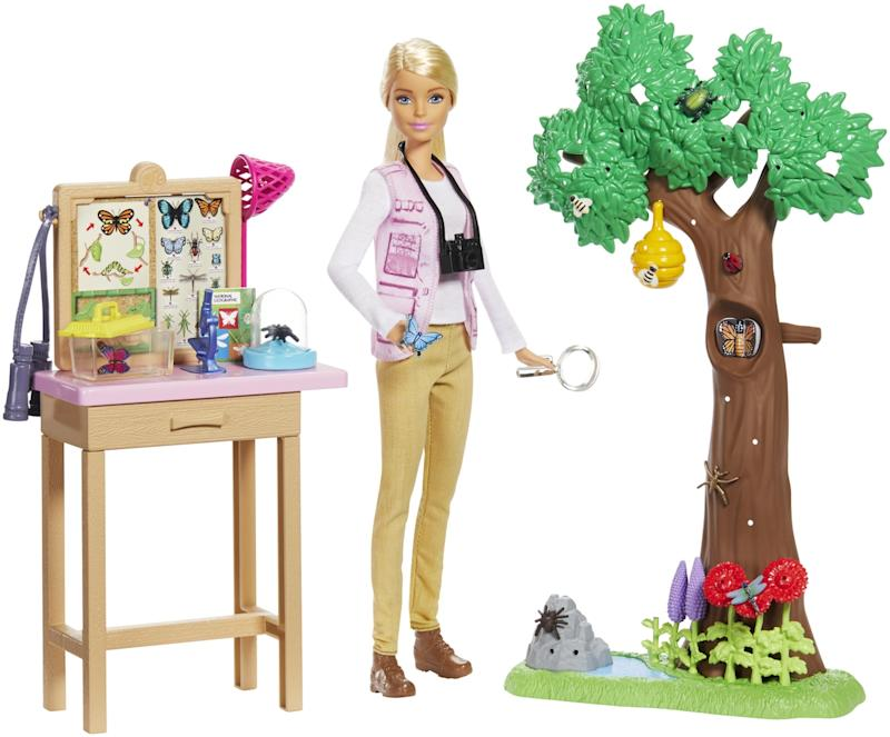 A Barbie doll with props
