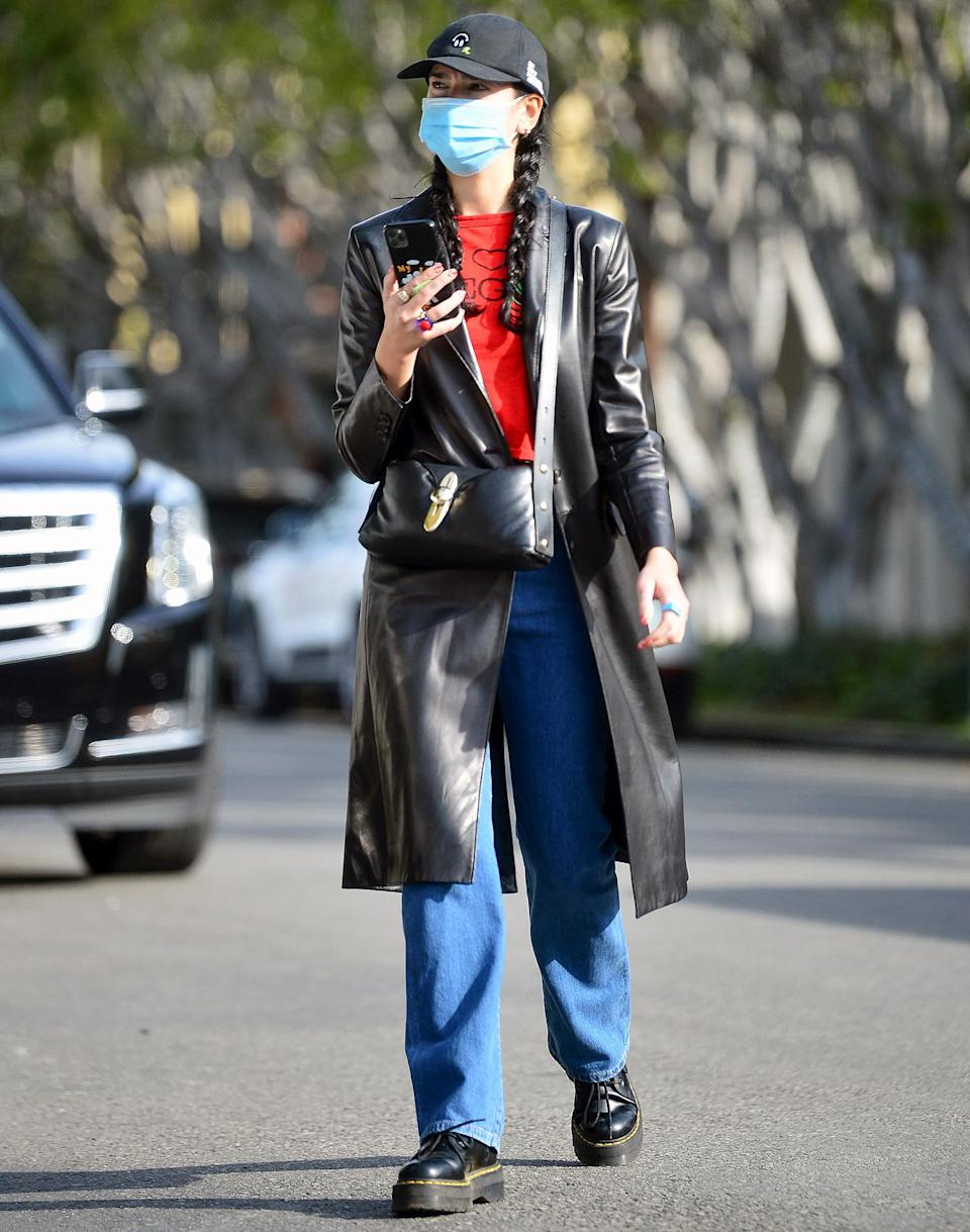 <p>Dua Lipa wears a leather coat, jeans and boots as she makes her way through L.A. on Tuesday.</p>