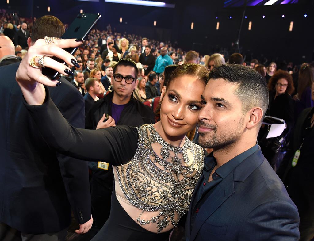 <p>Jennifer Lopez snapped a selfie with <i>NCIS</i> star Wilmer Valderrama at the People's Choice Awards on what turned out to be a big night for her. After being nominated at the awards show three times in previous years, J.Lo finally took home a trophy, as she was named Favorite TV Crime Drama Actress for her role on <i>Shades of Blue</i>. (Photo: Kevin Mazur/WireImage) </p>