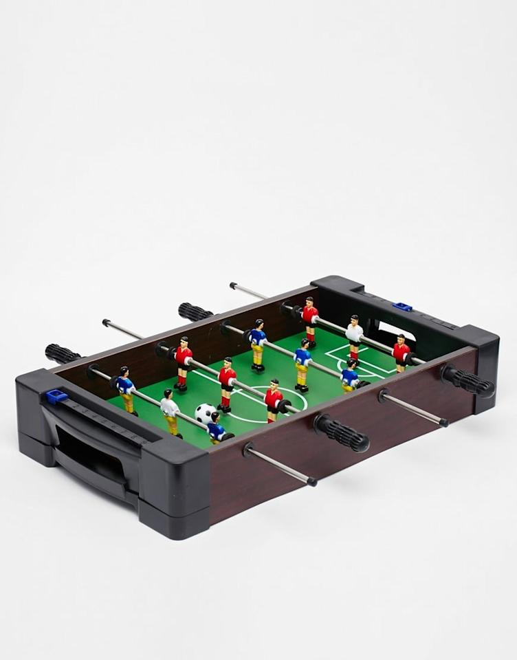 """<p>Everyone could use this fun <a href=""""https://www.popsugar.com/buy/Tabletop-Foosball-Game-105207?p_name=Tabletop%20Foosball%20Game&retailer=amazon.com&pid=105207&price=22&evar1=savvy%3Aus&evar9=41791804&evar98=https%3A%2F%2Fwww.popsugar.com%2Fsmart-living%2Fphoto-gallery%2F41791804%2Fimage%2F46988616%2FTabletop-Foosball-Game&list1=shopping%2Cgifts%2Camazon%2Cgadgets%2Choliday%2Cwellness%2Cgift%20guide%2Cconsumerism%2Ctech%20shopping%2Cgifts%20under%20%24100%2Cgifts%20under%20%2450%2Cgifts%20under%20%2475%2Cgifts%20under%20%24200%2Cbest%20of%202019&prop13=mobile&pdata=1"""" rel=""""nofollow"""" data-shoppable-link=""""1"""" target=""""_blank"""" class=""""ga-track"""" data-ga-category=""""Related"""" data-ga-label=""""https://www.amazon.com/dp/B0056IXFQ2/"""" data-ga-action=""""In-Line Links"""">Tabletop Foosball Game</a> ($22) in their life.</p>"""