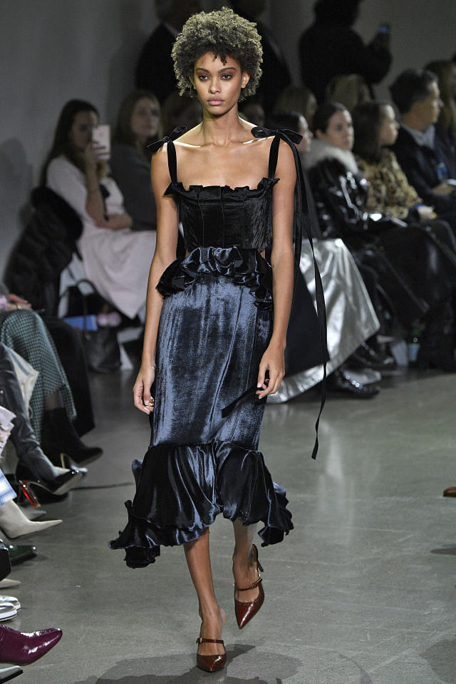 <p>A black-and-blue velvet dress at the Brock Collection FW18 show. (Photo: Getty) </p>