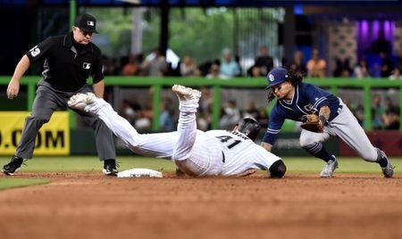 Jun 9, 2018; Miami, FL, USA; Miami Marlins first baseman Justin Bour (41) slides into second base on a double as San Diego Padres shortstop Freddy Galvis (13) is late on the tag in the sixth inning at Marlins Park. Mandatory Credit: Steve Mitchell-USA TODAY Sports