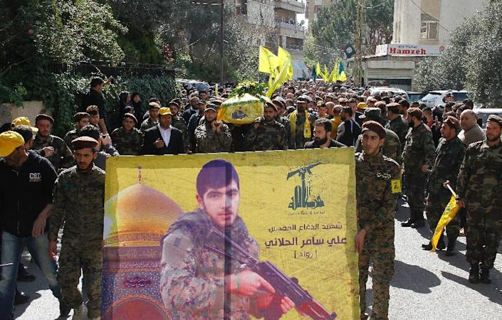 Hezbollah fighters carry the coffin of one of their comrades, killed fighting alongside government forces in Syria, during his funeral in the Mount Lebanon village of Qmatiyeh, southeast of Beirut, on March 25, 2015 (AFP Photo/)
