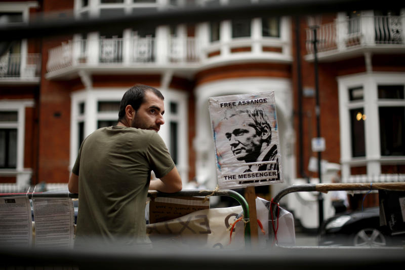 "A supporter of WikiLeaks founder Julian Assange maintains a presence outside the Ecuador embassy in London, as he continues his refuge there, Monday, Aug. 20, 2012.  Wikileaks founder Julian Assange portrayed himself Sunday as a victim of an American ""witch hunt"" over his secret-spilling website in a defiant address from the balcony of the embassy where he is holed up to avoid extradition to face sex assault allegations.  Surrounded by British police who want to detain him, Assange made no mention of the sex assault case in Sweden or how long he would remain in Ecuador's embassy in London, where he took refuge two months ago.  (AP Photo/Matt Dunham)"