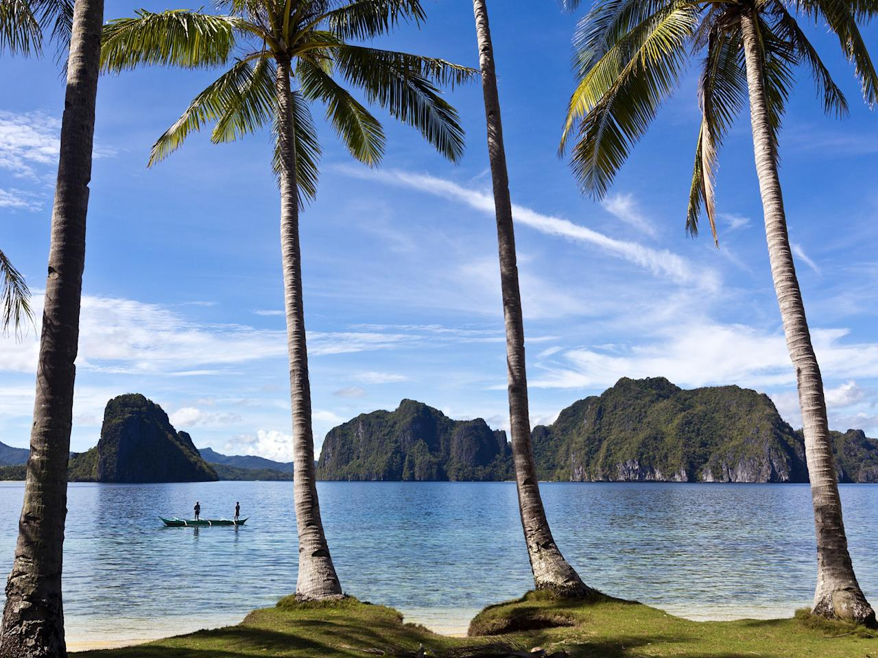 """<p>A regular on our list of the world's best islands, Palawan is home to the otherworldly <a href=""""http://www.cntraveler.com/galleries/2014-10-10/palawan-why-you-should-visit-this-natural-wonder-in-the-philippines?mbid=synd_yahoo_rss"""">Puerto Princesa Subterranean River</a>, a UNESCO World Heritage Site worth the trip alone. Many make El Nido and its blue lagoon their base, though, to explore the Bacuit Archipelago.</p> <p><strong>Pro tip</strong>: Puerto Princesa is one of the longest underground rivers in the world, traveling five miles through a subterranean cave system. Guided boat tours take visitors down a portion of the waterway, where karsts—natural rock formations created by dissolving limestone—loom in every direction.</p> <p><strong>Getting there</strong>: From Manila, it's an hour-and-15-minute flight to Puerto Princesa, Palawan's main airport. Alternately, ferries travel between Manila and the island several days a week (about 24 hours each way).</p>"""