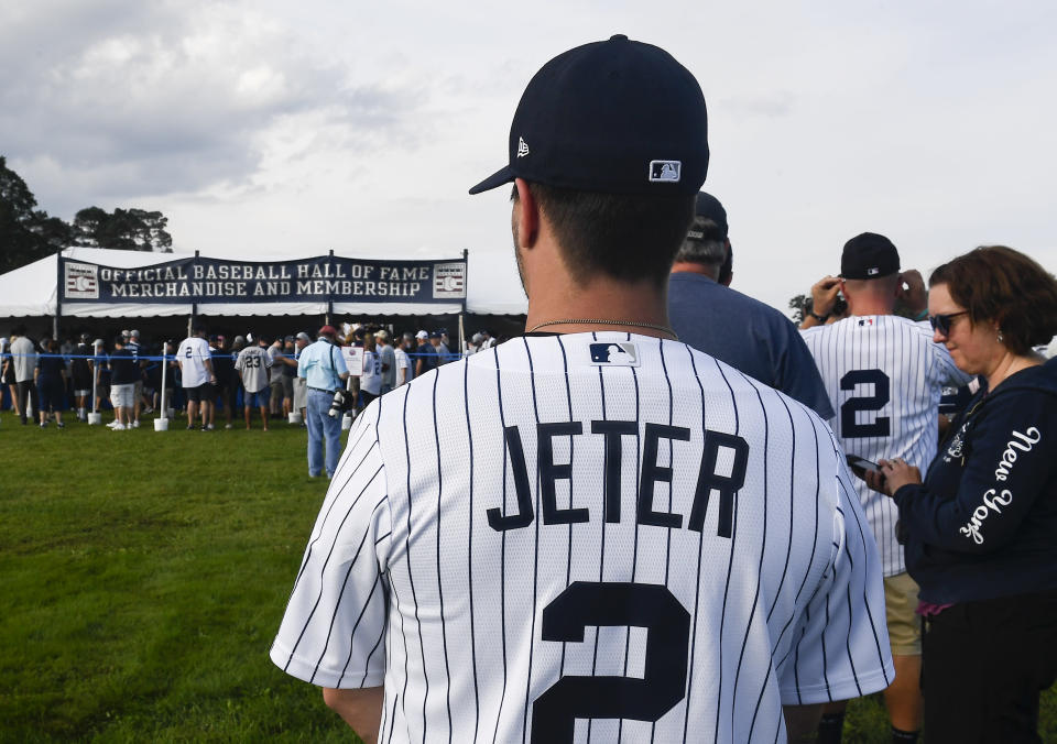 Fans wait in line to purchase baseball merchandise while attending the National Baseball Hall of Fame induction ceremony at the Clark Sports Center, Wednesday, Sept. 8, 2021, in Cooperstown, N.Y. (AP Photo/Hans Pennink)