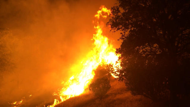 <p>In this photo provided by the California Department of Forestry and Fire Protection, the Pawnee Fire wildfire burns northeast of Clearlake Oaks, Calif., early Sunday, June 24, 2018. The fire burned actively throughout the night in the Spring Valley area, northeast of Clearlake Oaks in Lake County. The Pawnee Fire, which broke out Saturday, was one of four wildfires burning in largely rural areas as wind and heat gripped a swath of California from San Jose to the Oregon border. (Photo: Jonathan Cox/California Department of Forestry and Fire Protection via AP) </p>