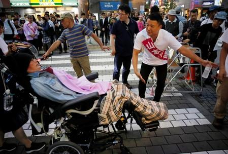 Reiwa Shinsengumi's cadidate for Japan's July 21 upper house election, who has ALS, attends an election campaign in Tokyo