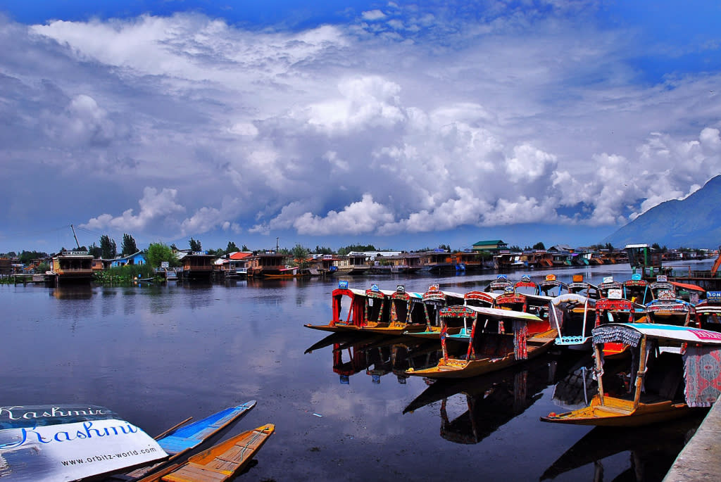 <p>Srinagar, with its picturesque lakes (Dal Lake, Nigeen Lake, and Wular Lake), shimmering Jhelum River, and surrounding mountain range, is a refreshing destination this time of year. Then take a two-hour drive to an even more stunning destination—Gulmarg. Translated into 'meadow of flowers', Gulmarg is famous for its proximity to Apharwat Peak located 4,200 metres above sea level. It's is one of the world's highest ski resorts. Take in the stunning views of the snow-laden Himalayas and explore some of the fauna and flora of the region at the Gulmarg Biosphere Reserve, a draw for wildlife lovers and photographers alike. Another draw is the Gulmarg Golf Course, the highest 18-hole golf course in India.<br />Photograph: Basharat Alam Shah/Flickr </p>