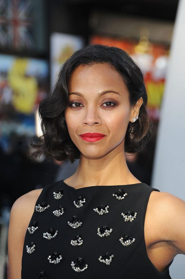 <p>Saldana takes a vacation from her signature long locks with an elegant asymmetrical cut and a red lip. </p>