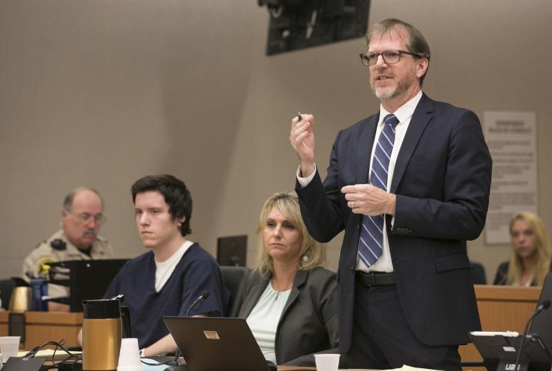 John O'Connell, attorney for John Ernest, left, cross examines witness Oscar Stewart during a preliminary hearing for Earnest, Thursday, Sept. 19, 2019, in Superior Court in San Diego. Prosecutors say Earnest opened fire during a Passover service at the Chabad of Poway synagogue on April 27, killing one woman and injuring three people, including the rabbi. (John Gibbins/The San Diego Union-Tribune via AP, Pool)