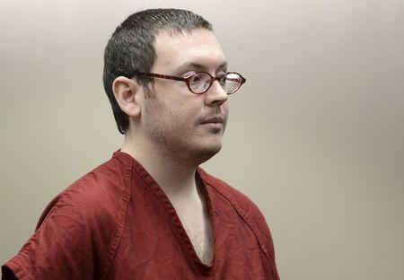 Colorado movie massacre gunman James Holmes listens at a court hearing before beginning his life sentence with no chance of parole, in Centennial, Colorado
