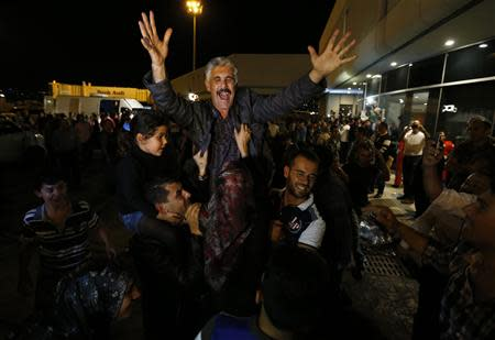 One of the nine newly released Lebanese hostages, who were held by rebels in northern Syria, gestures as he is welcomed by his relatives upon his arrival at Beirut international airport