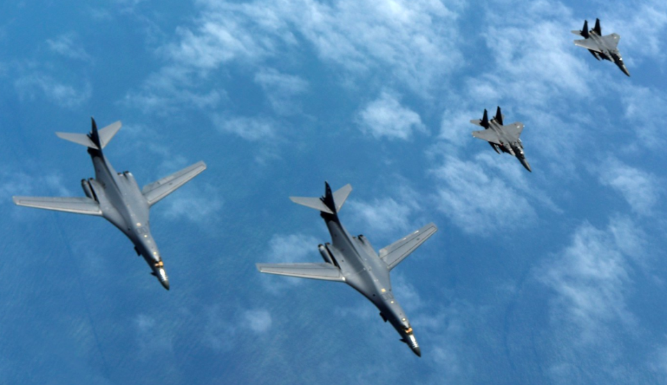 <em>Two U.S. Air Force B-1B Lancers assigned to the 9th Expeditionary Bomb Squadron, deployed from Dyess Air Force Base, Texas, fly a 10-hour mission from Andersen Air Force Base, Guam in June (Rex)</em>