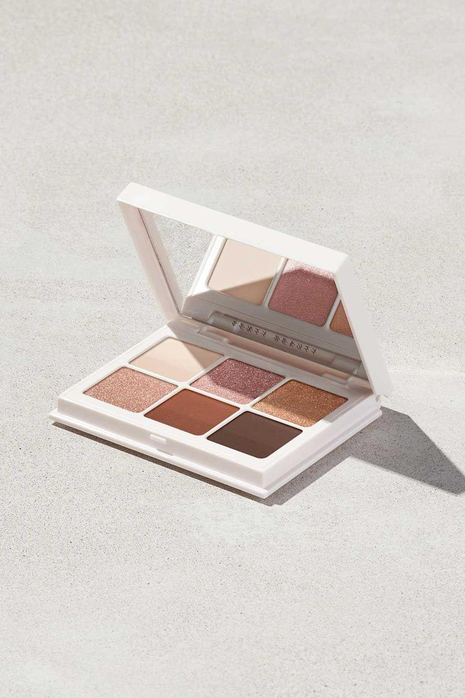 """<p><strong>Fenty Beauty</strong></p><p>fentybeauty.com</p><p><a href=""""https://go.redirectingat.com?id=74968X1596630&url=https%3A%2F%2Fwww.fentybeauty.com%2Fsnap-shadows-mix-and-match-eyeshadow-palette%2FFB70023.html%3Fdwvar_FB70023_color%3DFB9034%26cgid%3Dmakeup-eye&sref=https%3A%2F%2Fwww.cosmopolitan.com%2Fstyle-beauty%2Fbeauty%2Fg34399952%2Ffenty-beauty-sale-october-2020%2F"""" rel=""""nofollow noopener"""" target=""""_blank"""" data-ylk=""""slk:SHOP IT"""" class=""""link rapid-noclick-resp"""">SHOP IT </a></p><p><strong><del>$25</del> $16.87 (33% off)</strong></p><p>Why not spend this time inside perfecting your smokey eye? With six gorgeous shades to choose from, this eyeshadow palette gives you plenty of options to play with. </p>"""