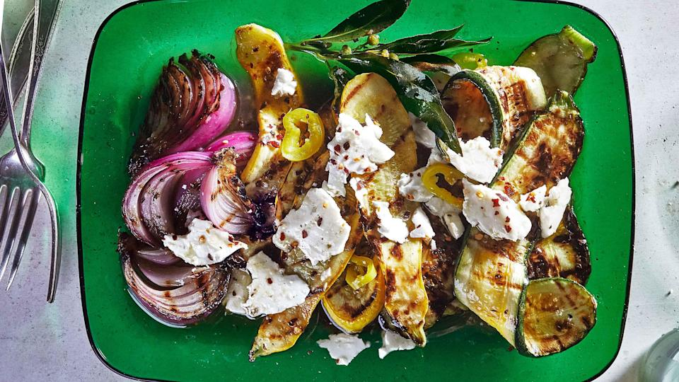 "Say it with us: No more squishy, bland summer squash! This year, we're flipping the script and marinating <em>after</em> grilling. Inspired by the technique called escabèche, where cooked fish and meat are preserved in an acidic mixture, we're cooking first, marinating second. In the case of squash, it produces maximum flavor without compromising char or texture. To ensure that the squash is crisp-tender, do pull it off the grill as soon as it's picked up some grill marks and a paring knife easily slips through the flesh. <a href=""https://www.bonappetit.com/recipe/grilled-summer-squash-and-red-onion-with-feta?mbid=synd_yahoo_rss"" rel=""nofollow noopener"" target=""_blank"" data-ylk=""slk:See recipe."" class=""link rapid-noclick-resp"">See recipe.</a>"