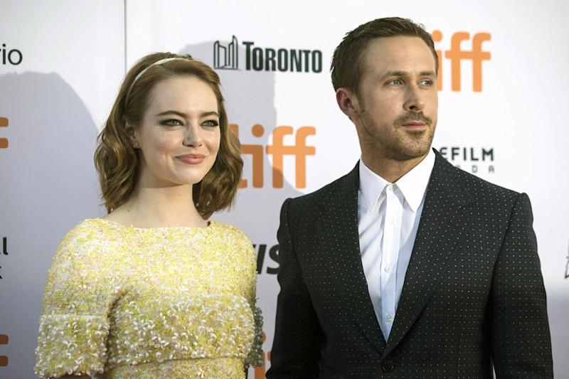 "Ryan Gosling, right, and Emma Stone arrive on the red carpet for the film ""La La Land"" during the 2016 Toronto International Film Festival in Toronto on Monday, Sept. 12, 2016. (Chris Young/The Canadian Press via AP)"