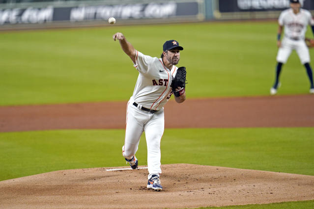 Houston Astros starting pitcher Justin Verlander throws against the Seattle Mariners during the first inning of a baseball game Friday, July 24, 2020, in Houston. (AP Photo/David J. Phillip)
