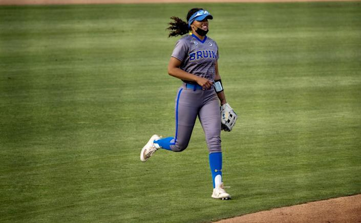 UCLA's Maya Brady runs in from center field during a game against Oregon State on April 16 in Westwood.