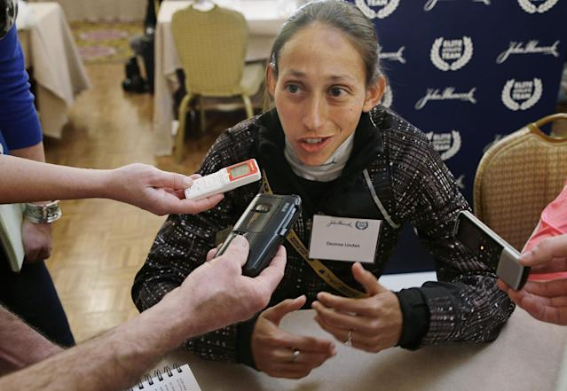 Boston Marathon runner Desiree Linden answers a reporter's question during a media availability of Boston Marathon elite runners at the Copley Plaza Hotel in Boston Friday April 18, 2014. The 118th running of the Boston Marathon is Monday April 21, 2014. (AP Photo/Stephan Savoia)