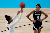 Louisville guard Kianna Smith (14) shoots a free throw while Northwestern guard Sydney Wood (3) watches during the second half of a college basketball game in the second round of the women's NCAA tournament at the Alamodome in San Antonio, Wednesday, March 24, 2021. Louisville won 62-53. (AP Photo/Charlie Riedel)