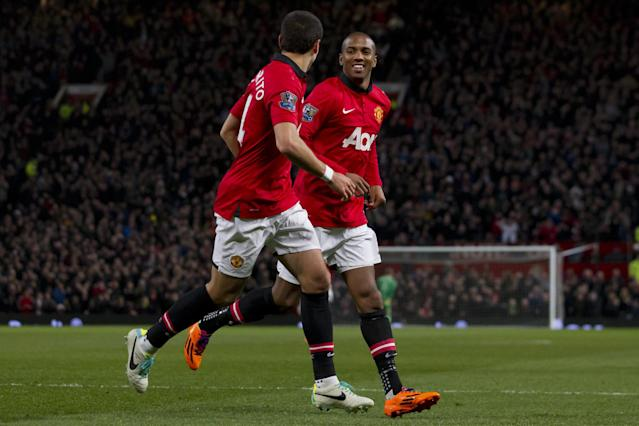 Manchester United's Ashley Young, right, celebrates after scoring against West Ham United during their English Premier League soccer match at Old Trafford Stadium, Manchester, England, Saturday Dec. 21, 2013. (AP Photo/Jon Super)