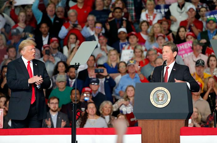 Then-candidate for governor Brian Kemp (R) at a campaign rally with President Donald Trump on Nov. 4 in Macon, Georgia.Kemp won a narrow victory over Democratic candidate Stacey Abrams, amid accusations that he used his position as secretary of state to his advantage. (Photo: ASSOCIATED PRESS)