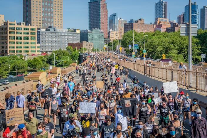 The immense crowd of protesters taking the Manhattan inbound roadway at the march across the Brooklyn Bridge.(Erik McGregor/LightRocket via Getty Images)