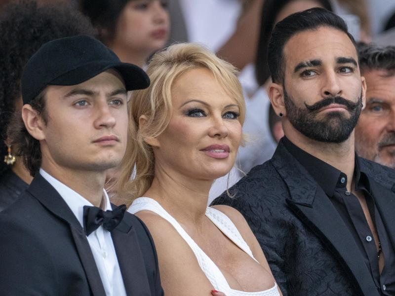 MONTE-CARLO, MONACO - MAY 24: (L-R) Brandon Thomas Lee, Pamela Anderson and Adil Rami attend Amber Lounge 2019 Fashion Show on May 24, 2019 in Monte-Carlo, Monaco. (Photo by Arnold Jerocki/Getty Images)
